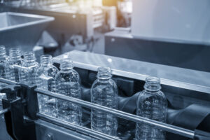 the-pet-bottles-on-the-conveyor-belt-for-filling-process-in-the